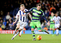 Gylfi Sigurdsson of Swansea City chased by James McClean of West Bromwich Albion during the Barclays Premier League match between West Bromwich Albion and Swansea City at The Hawthorns on the 2nd of February 2016