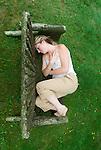 Blonde woman sitting on bench