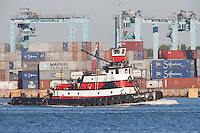 Tugboat Captain D passes the A.P. Moller-Maersk facility in the Port Newark-Elizabeth Marine Terminal in Newark Bay.