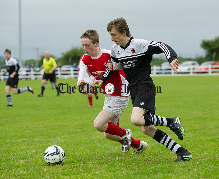 Conor Mc Carthy of Newmarket Celtic in action against Simon Ralph of Moher Celtic during their U-19 final at The County Grounds, Doora. Photograph by John Kelly.