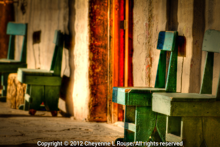 A lazy old west veranda in Old Tucson w/ green chairs - Arizona.