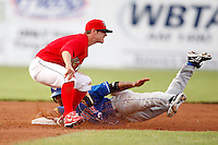 June 19, 2009:  Second Baseman Devin Goodwin of the Batavia Muckdogs takes the throw as Eric Eiland slides in during a game at Dwyer Stadium in Batavia, NY.  The Muckdogs are the NY-Penn League Short-Season Class-A affiliate of the St. Louis Cardinals.  Photo by:  Mike Janes/Four Seam Images