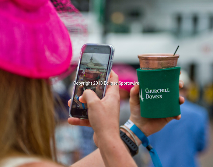 LOUISVILLE, KY - MAY 05: A woman takes a phoy of her Woodford Reserve Spire on Kentucky Derby Day at Churchill Downs on May 5, 2018 in Louisville, Kentucky. (Photo by Scott Serio/Eclipse Sportswire/Getty Images)