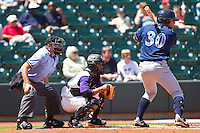John Whittleman #30 of the Wilmington Blue Rocks waits for a pitch as catcher Luis Sierra #7 of the Winston-Salem Dash and home plate umpire Mike Walsh look on at BB&T Ballpark on April 24, 2011 in Winston-Salem, North Carolina.   Photo by Brian Westerholt / Four Seam Images