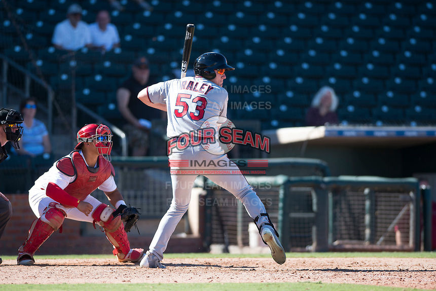 Salt River Rafters left fielder Luke Raley (53), of the Minnesota Twins organization, at bat in front of catcher Jeremy Martinez (4) during an Arizona Fall League game against the Surprise Saguaros on October 9, 2018 at Surprise Stadium in Surprise, Arizona. The Rafters defeated the Saguaros 10-8. (Zachary Lucy/Four Seam Images)
