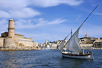 Man sailing in a yacht with Saint Jean Fort in the background, Marseille, France.