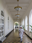 18 August 2015,Colombo, Sri Lanka:  Chefs walk the tiled hallway to the bistro area at the historic Galle Face Hotel,  Colombo, Sri Lanka.     Picture by Graham Crouch