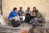 Jaipur, Rajasthan, India.  Five Men in Discussion.