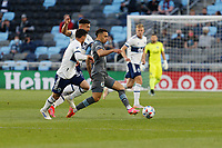 SAINT PAUL, MN - MAY 12: Hassani Dotson #31 of Minnesota United FC passes the ball during a game between Vancouver Whitecaps and Minnesota United FC at Allianz Field on May 12, 2021 in Saint Paul, Minnesota.