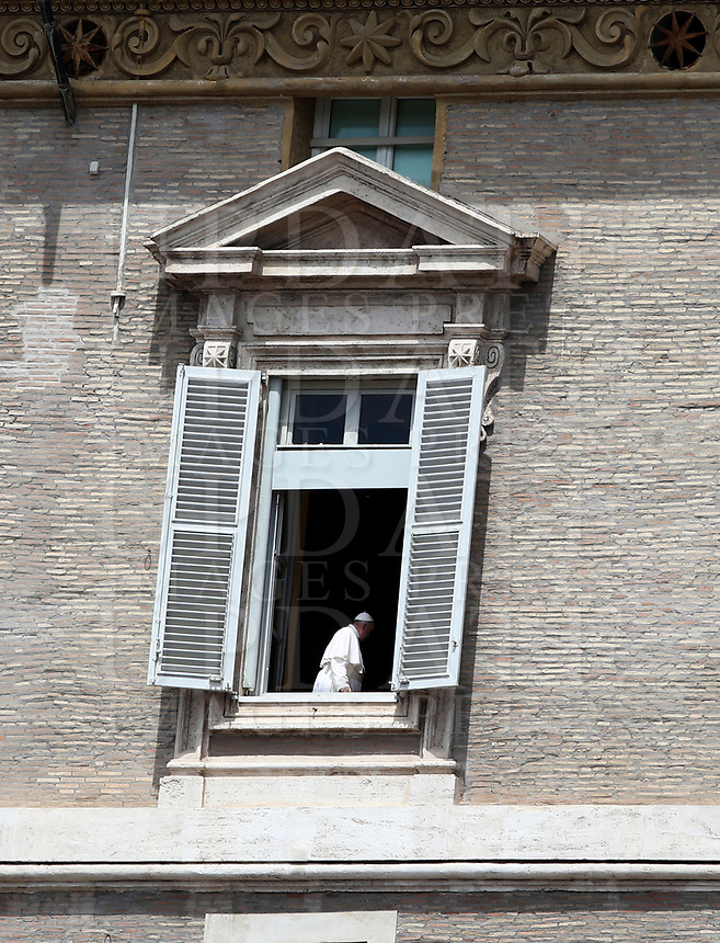 Pope Francis gets back in after appearing to deliver his blessing from the window of the Apostolic Palace overlooking an empty St Peter' square, closed off to the public due to the novel coronavirus, COVID-19, pandemic, after his live-streamed Angelus prayer on May 10, 2020 at the Vatican. <br /> UPDATE IMAGES PRESS/Isabella Bonotto<br /> <br /> STRICTLY ONLY FOR EDITORIAL USE