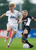 Margaret Tietjen of the Power and Cindy Parlow of the Beat both go for the ball. The Atlanta Beat and the NY Power played to a 1-1 tie on 7/26/03 at Mitchel Athletic Complex, Uniondale, NY.