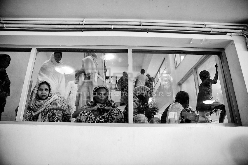 Relatives of the victim of Rana plaza collapse waiting inside of the Anam medical college hospital, in Savar, near Dhaka, Bangladesh