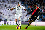 Karim Benzema of Real Madrid (L) fights for the ball with Abdoulaye Ba, A Ba, of Rayo Vallecano during the La Liga 2018-19 match between Real Madrid and Rayo Vallencano at Estadio Santiago Bernabeu on December 15 2018 in Madrid, Spain. Photo by Diego Souto / Power Sport Images