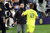 NASHVILLE, TN - SEPTEMBER 23: Head coach Gary Smith of Nashville SC gives last minute instructions to Alan Winn #19 of Nashville SC before subbing him in during a game between D.C. United and Nashville SC at Nissan Stadium on September 23, 2020 in Nashville, Tennessee.