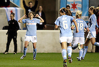 Chicago Red Stars forward Karen Carney (14) points to the back of her jersey after scoring the Red Stars' third goal.  The Chicago Red Stars defeated the Boston Breakers 4-0 at Toyota Park in Bridgeview, IL on April 25, 2009.