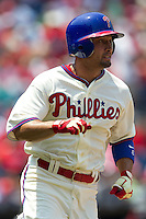 Philadelphia Phillies outfielder Shane Victorino #8 runs to first base during the Major League Baseball game against the Pittsburgh Pirates on June 28, 2012 at Citizens Bank Park in Philadelphia, Pennsylvania. The Pirates defeated the Phillies 5-4. (Andrew Woolley/Four Seam Images).