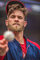 20 April 2013: Washington Nationals outfielder Bryce Harper tosses a baseball to a fan prior to a game against the New York Mets at Citi Field in Flushing, NY. Harper went 3 for 3 with 3 RBIs and two home runs as the Nationals defeated the Mets 7-6 to tie their 3-game series at one a piece. Mandatory Credit: Ed Wolfstein Photo *** RAW (NEF) Image File Available ***