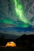 Green northern lights over tent camp in the Brooks Range, Arctic, Alaska.