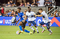 SAN JOSE, CA - AUGUST 13: Jeremy Ebobisse #11 of the San Jose Earthquakes  dribbles the ball past Leonard Owusu #17 and Ranko Veselinovic #4 of the Vancouver Whitecaps during a game between San Jose Earthquakes and Vancouver Whitecaps at PayPal Park on August 13, 2021 in San Jose, California.
