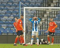 7th November 2020 The John Smiths Stadium, Huddersfield, Yorkshire, England; English Football League Championship Football, Huddersfield Town versus Luton Town; Carel Eiting of Huddersfield Town sees James Shea of Luton Town gather the ball
