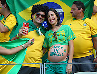 A pregnant Brazil fan with 'Made in Brazil' painted on her stomach