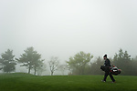 JEJU, SOUTH KOREA - APRIL 22:  Richard Finch's caddie walks through the fog during the Round One of the Ballantine's Championship at Pinx Golf Club on April 22, 2010 in Jeju island, South Korea. Photo by Victor Fraile / The Power of Sport Images