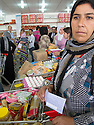Iraq 2013 .Next to the Domiz Refugee Camp, the supermarket where the refugees  making their shopping pay with coupons .Irak 2013.A la sortie du camp de Domiz, le supermarche ou les refugies du camp viennent faire leurs courses payant avec des coupons