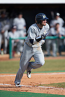 Colin Woody (22) of the UNCG Spartans hustles down the first base line against the High Point Panthers at Willard Stadium on February 14, 2015 in High Point, North Carolina.  The Panthers defeated the Spartans 12-2.  (Brian Westerholt/Four Seam Images)