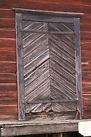 Traditional style Swedish wooden painted house. Black door. Fading peeling painting. Smaland region. Sweden, Europe.