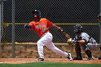 GCL Astros third baseman Reiny Beltre (48) at bat in front of catcher Collin Yelich during a game against the GCL Braves on July 23, 2015 at the Osceola County Stadium Complex in Kissimmee, Florida.  GCL Braves defeated GCL Astros 4-2.  (Mike Janes/Four Seam Images)