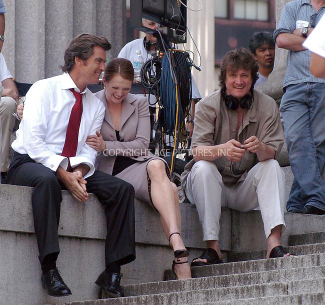 """Pierce Brosnan, Julianne Moore and director Peter Howitt on the set of their new movie, """"The Laws of Attraction"""" on the steps of Manhattan's Courthouse. New York, August 14, 2003. Please byline: NY Photo Press.   ..*PAY-PER-USE*      ....NY Photo Press:  ..phone (646) 267-6913;   ..e-mail: info@nyphotopress.com"""