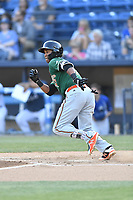 Greensboro Grasshoppers third baseman Marcos Rivera (11) runs to first base during a game against the Asheville Tourists at McCormick Field on May 10, 2018 in Asheville, North Carolina. The Tourists defeated the Grasshoppers 14-10. (Tony Farlow/Four Seam Images)