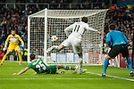 Bale of Real Madrid and Minev of Ludogorets during Champions League match between Real Madrid and Ludogorets at Santiago Bernabeu Stadium in Madrid, Spain. December 09, 2014. (ALTERPHOTOS/Luis Fernandez)