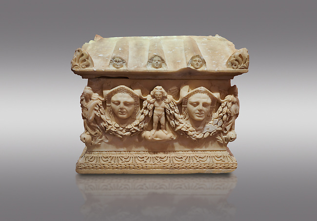 Roman relief sculpted Ostothec cremation sarcophagus, 2nd century AD, Perge. An ostothec is used to preserve the ashes and bones of the dead bodies after their cremation, takes its form from a small sarcophagus. This ostothec is a miniature example of the garland sarcophagus. Antalya Archaeology Museum, Turkey. Against a grey background.. Against a warm art background.