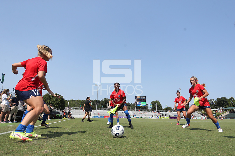 CARY, NC - SEPTEMBER 12: Amy Rodriguez #12, Taylor Smith #2, Angharad James #34, and Brittany Ratcliffe #27 of the North Carolina Courage play a small sided game before a game between Portland Thorns FC and North Carolina Courage at Sahlen's Stadium at WakeMed Soccer Park on September 12, 2021 in Cary, North Carolina.