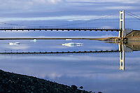 Bridge crossing over icebergs floating in the waters of Jokulsarlon Lagoon, Iceland.