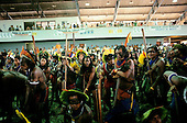 Altamira, Para State, Brazil. Group of Indians in a meeting hall protesting against dam construction.