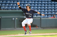 Ryan Fitzgerald (24) of the Greenville Drive evades a rundown and scores a run in Game 1 of a doubleheader against the Rome Braves on Friday, August 3, 2018, at Fluor Field at the West End in Greenville, South Carolina. Rome won, 7-6. (Tom Priddy/Four Seam Images)