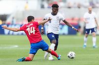 SANDY, UT - JUNE 10: Yunus Musah #18 of the United States moves with the ball during a game between Costa Rica and USMNT at Rio Tinto Stadium on June 10, 2021 in Sandy, Utah.