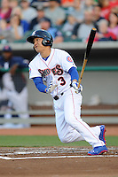 Tennessee Smokies right fielder Jae-Hoon Ha #4 swings at a pitch during a game against Huntsville Stars at Smokies Park on April 25, 2014 in Kodak, Tennessee. The Stars defeated the Smokies 15-1. (Tony Farlow/Four Seam Images)