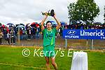 Kerry captain Áine O'Connor raises the Muster Junior Championship cup