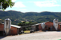 Near Spoleto: A farm in the countryside with small old silos in the courtyard.
