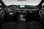 Stock photo of straight dashboard view of 2017 BMW 3-Series 330i 4 Door Sedan Dashboard