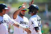 Augusta GreenJackets Jeffry Parra (26) high fives Jose Layer (22) during a South Atlantic League game against the Lexington Legends on April 30, 2019 at SRP Park in Augusta, Georgia.  Augusta defeated Lexington 5-1.  (Mike Janes/Four Seam Images)