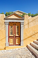 Old door of a mansion at the upper town (Chorio) of Symi island, Greece