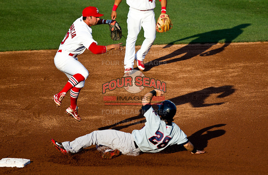 Greg Garcia (10) of the Springfield Cardinals leaps while turning a double play during a game against the Arkansas Travelers at Hammons Field on May 5, 2012 in Springfield, Missouri. (David Welker/Four Seam Images)
