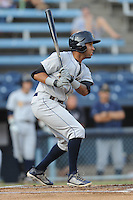 Charleston River Dogs shortstop Cito Culver #2 swings at a pitch during a game against the Asheville Tourists at McCormick Field on August 15, 2012 in Asheville, North Carolina. The Tourists defeated the River Dogs 6-0. (Tony Farlow/Four Seam Images).