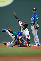 Kervin Suarez (36) of the Greenville Drive and shortstop Jeison Guzman (11) of the Lexington Legends both await the unpire's call after Suarez stole second base during a game on Sunday, September 2, 2018, at Fluor Field at the West End in Greenville, South Carolina. Greenville won, 7-4. (Tom Priddy/Four Seam Images)