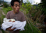 Marcos Marcelino Coronado Barrios with his 10-day-old newborn talks about a survival through 7.4 earthquake struck Guatemala Wednesday Nov. 7.
