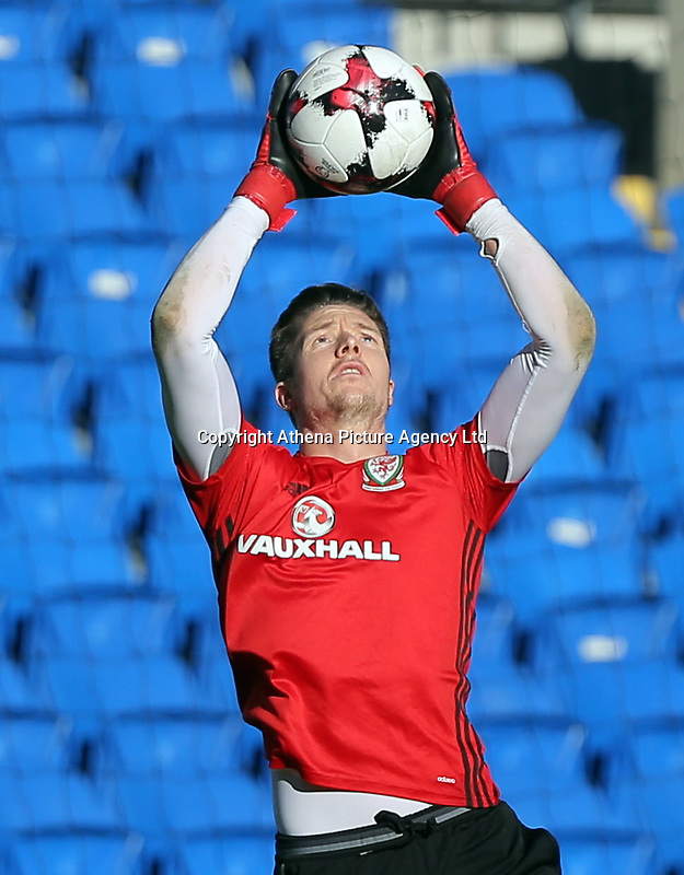 Wayne Hennessey jumps to grab the ball during the Wales Press Conference and Training Session at The Cardiff City Stadium, Wales, UK. Monday 13 November 2017